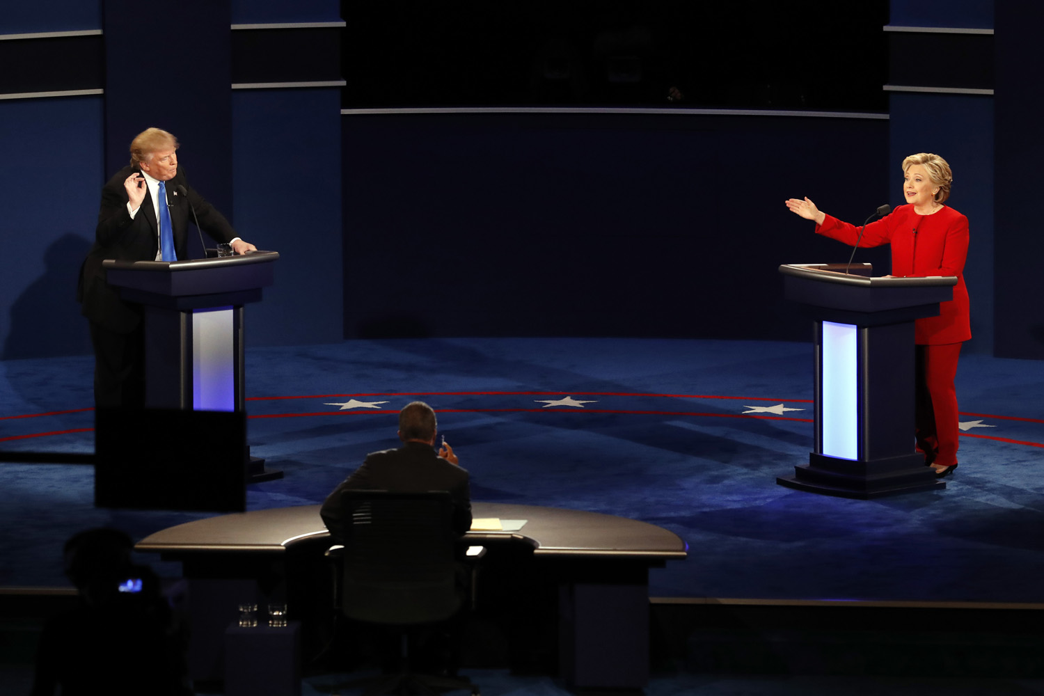 Republican presidential nominee Donald Trump and Democratic presidential nominee Hillary Clinton gesture during the presidential debate at Hofstra University in Hempstead, N.Y., Monday, Sept. 26, 2016. (AP Photo/Mary Altaffer)