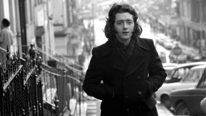 For 'READY FOR TARK' Feature on rock musician Rory Gallagher 3/1/1974 Ref. 168/92 old black and white guitarists blues taste